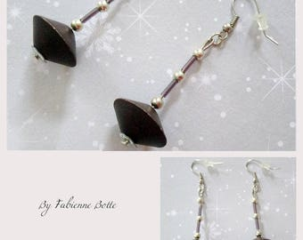 Silver color with wooden diamond shaped bead earrings.