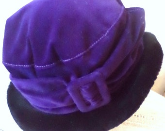Velvet purple hat with a fur field. Vintage hat for the spring. Style of the year 1970.