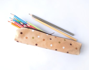 Small pencil case/zipper pouch in light brown with dots in earthy browns, green and white with a dark brown zip