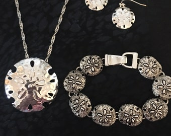 Sterling Silver Sand Dollar And Flower Necklace, Bracelet, And Earring Set