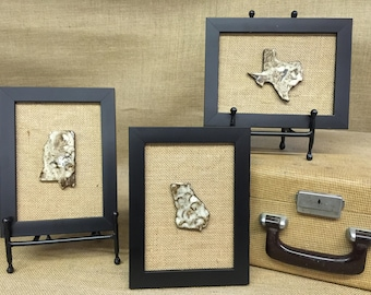 Hand-made pottery states framed with burlap background