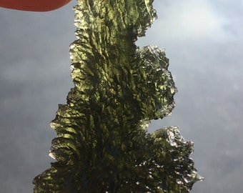 Moldavite   from  Czech Republic , 11,94 g , nice sculptured piece