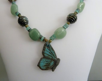 handmade green butterfly lampwork, ceramic and copper necklace, UK jewellery