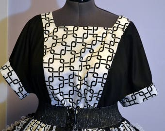 Pull over top with coordinating panel in front in black and white.