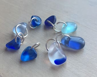 8 x genuine seaham sea glass, small to tiny pieces. Top drilled. Polished. Ideal charms. Blues and multis