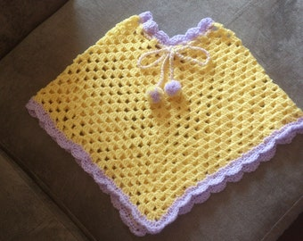 Poncho to fit child up to 6 months old.