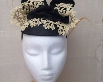 Handmade topper hat using moulded antique lace, ribbon and straw. For the races or wedding