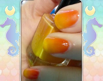 Sunshine - A thermal orange to yellow color changing nail polish
