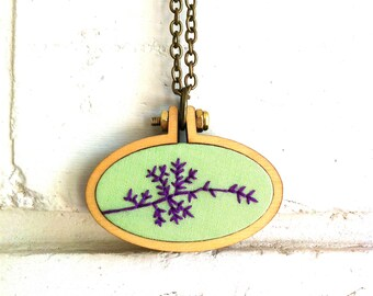 Hand Embroidered Necklace or Brooch. Nature. Branch. Silhouette. Green. Purple. Winter. Spring. Mini hoop frame. Wearable art.
