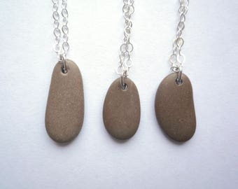 1 Small beige rock pendant on a solid sterling silver chain, Unpolished beach stone necklace