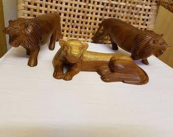 Lot of 3 solid dark wood lion figures