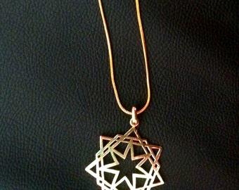 Hand cut symbolic brass pendant with chain