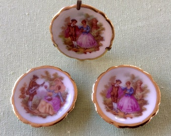 Limoges Plates.  Set of Three White Fragonard Courting Couple Designs. Two Bardet and one Meissner