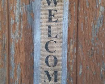 Wooden door sign and burlap Welcome basalt