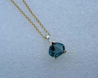 Blue Topaz and diamond pendant.