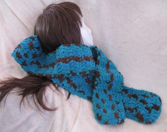 soft silky feeling thread haas ben crocheted into this scarf to help you stay warm.