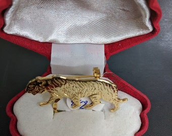 Tiger eyeglass holder pin.