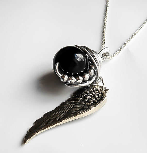 Final fantasy jewelry sephiroth necklace one winged angel like this item mozeypictures Choice Image