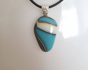 Blue and white reactive fused glass pendant