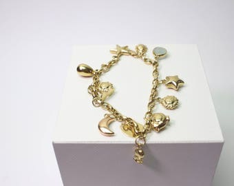 18k Solid Yellow Gold  Bracelet With 12 Different Pendants