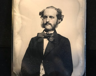 1/2 plate tintype  Photo man with mustache and beard.