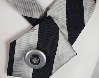 Women's necktie made using a repurposed necktie. Necktie jewelry made from an upcycled necktie.