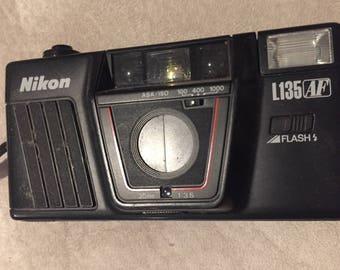 Vintage Nikon L125 AF 35mm Film Camera with Original Instructions and Leather Case