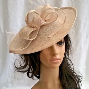 Stunning Champagne Sinamay Shaped disc Fascinator with swirls,loops & coque feathers..wedding,races