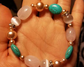 White cats eye. Blue turquoise and pink rose quartz beaded stretch bracelet