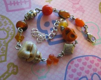 Mummy Skull Orange Skulls and Orange Beads Skull Charm Bracelet
