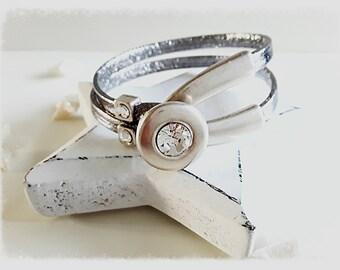 Swarovski button clasp silver metal leather bracelet.