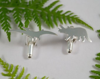 Silver Dinosaur cufflinks: A pair of Triceratops and Pterodactyl shaped sterling silver cufflinks.
