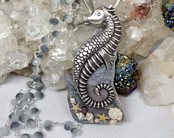 """Silver Seahorse Resting On An Agua Chalcedony Aura Quartz On 26"""" Facted Czech Glass Beaded Silver Wrapped Chain"""