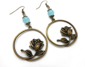 Earrings bronze flower, green natural freshwater pearl