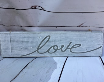 Wooden decorative inscription with the word love
