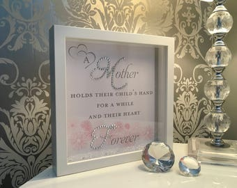 """A beautiful """"Mother hold 's their child's hand"""" 3D crystal box frame with pink flower detail."""