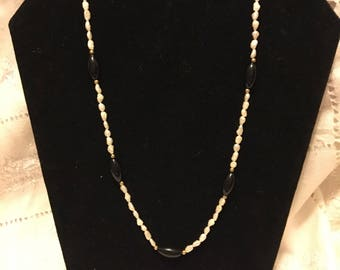"""Freshwater Pearls & Oynx spaced between 14k gold beads necklace. Necklace measures 20"""" and has a 14k gold clasp."""