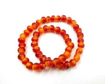 50 Perles en verre rouge/Orange - 4mm - 24-33