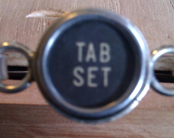 Tab set typewriter key bracelet
