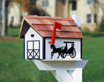Mailbox, traditional white mailbox with black horse and buggy on each side.