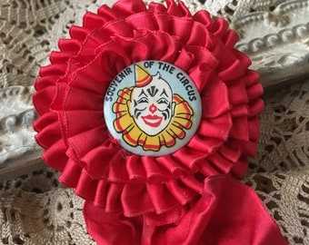 A Souvenir From The Circus With A Rosette Ribbon Lift