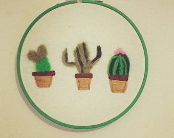 Felted and embroidered cactus tapestry
