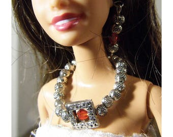 Tibetan Silver Barbie necklace with charm that has a red crystal in center. Handmade by Nims