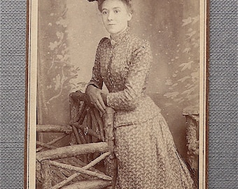 Carte-de-visite, antique.  Featuring a well dressed demure young lady.  T H Winterbourn, Leominster. c1890's.