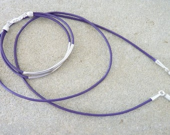 DRAWSTRING glasses purple leather and matching bracelet.
