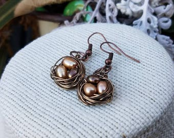 Wire Wrapped bird nest earrings with freshwater pearl eggs