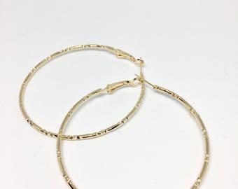 Gold etched hoop earrings