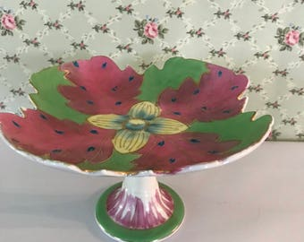 Colorful plate on pedestal