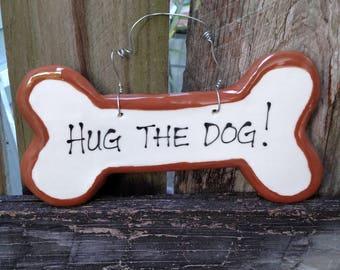 Hug the dog sign.