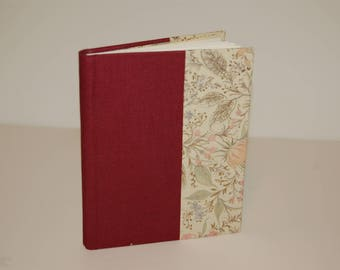 Handmade notebook  with red binding. Approximately 80 blank pages.